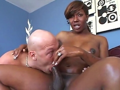 Black heavy chested shemale Chasidy with huge firm balloons and kinky haircut gives head to handsome stud with shaved head and gets her stiff pecker sucked in close up.