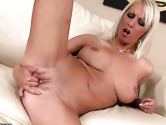 Blonde Pamela Blond with juicy hooters fucks herself with toy