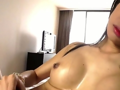 Ladyboy from Asian are showing us her big and hard cock, and how she can wank it like crazy! Of course this horny slut will cum in the end, how tones of warm sperm. enjoy!